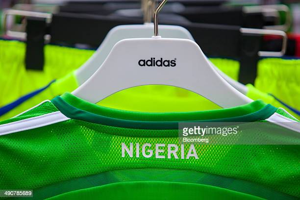 The official soccer shirt of Nigeria manufactured by Adidas AG hangs on display inside the sportswear company's headquarters in Herzogenaurach...