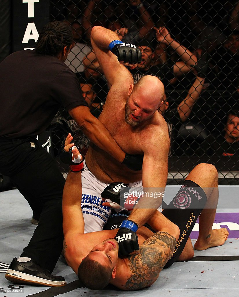 The official stops the fight as Ben Rothwell (top) punches Brendan Schaub during their heavyweight bout for UFC 145 at Philips Arena on April 21, 2012 in Atlanta, Georgia.