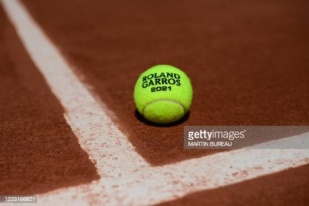 The official tennis ball is pictured on the tennis court during The Roland Garros 2021 French Open tennis tournament in Paris on May 29, 2021.