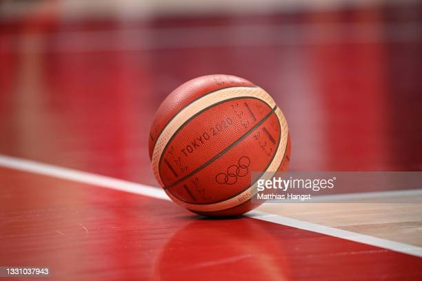 The official Tokyo 2020 Olympic basketball lays on the court during a Men's Preliminary Round Group A game between the United States and Iran on day...