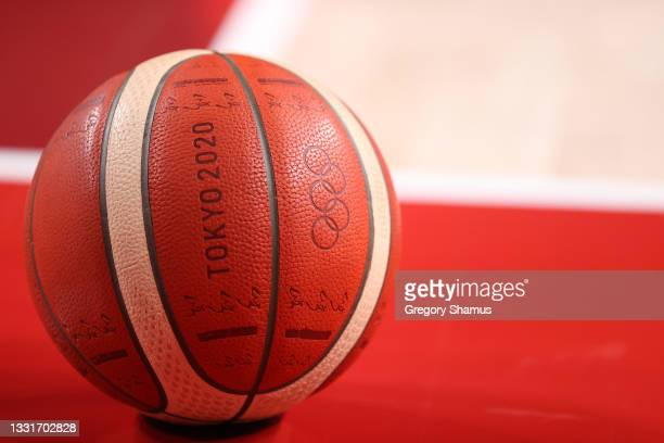 The official Tokyo 2020 Olympic basketball sits on the court during the first half of a Women's Basketball Preliminary Round Group A game between...