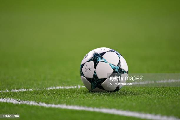 The official UEFA football sits on the pitch before the UEFA Champions League football match Real Madrid CF vs APOEL FC at the Santiago Bernabeu...
