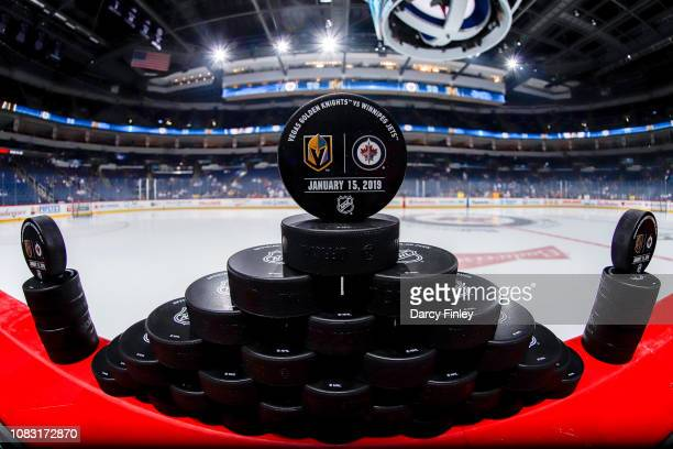 The official warm up pucks await the start of the pregame warm up between the Winnipeg Jets and the Vegas Golden Knights at the Bell MTS Place on...
