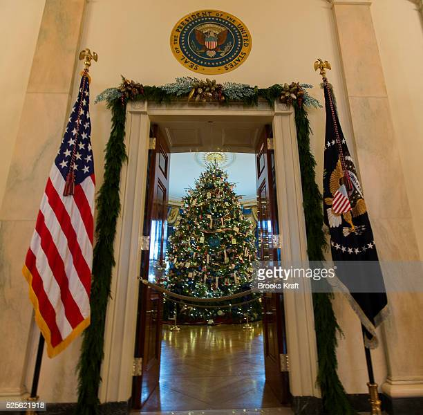The official White House Christmas Tree stands in the Blue Room of the White House in Washington DC US first lady Michelle Obama hosted military...