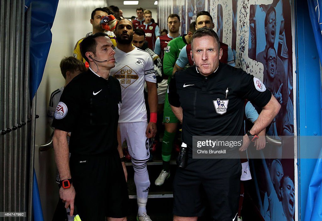 The officials and players prepare to walk out onto the pitch prior to kickoff during the Barclays Premier League match between Burnley and Swansea City at Turf Moor on February 28, 2015 in Burnley, England.