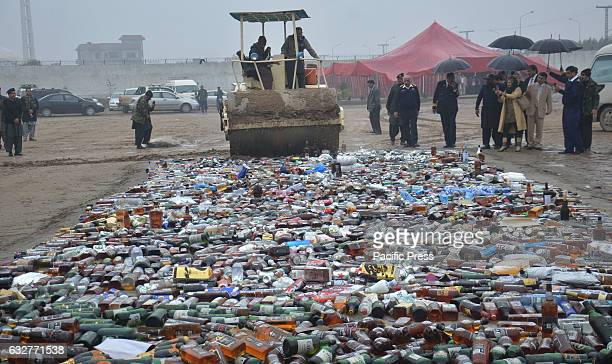 The officials break all the glass container of liquor Customs officials burn piles of drugs on International Customs Day Pakistani customs officials...