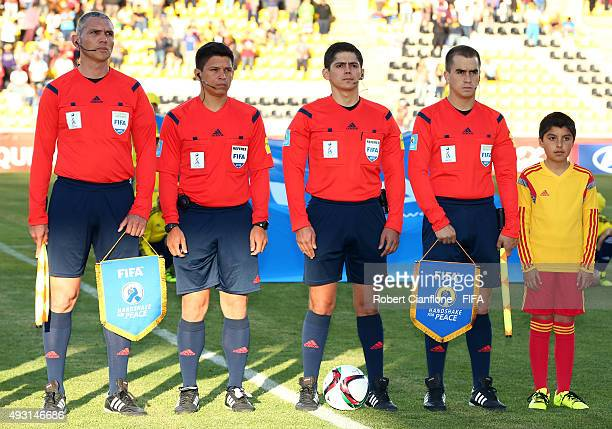 The officials line up for the FIFA U17 World Cup Group B match between Brazil and the Korea Republic at Estadio Francisco Sanchez Rumoroso on October...