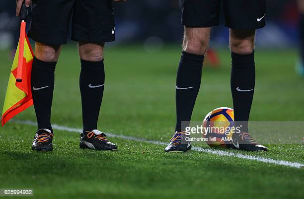 The officials wear Rainbow boot laces during the Premier League match between Chelsea and Tottenham Hotspur at Stamford Bridge on November 26 2016 in...