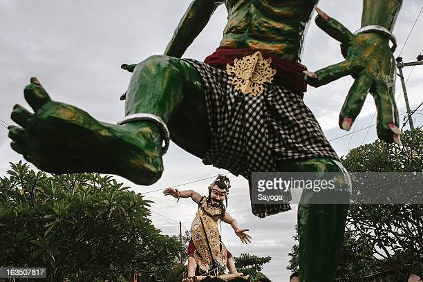The Ogoh-ogohs paraded in the street on March 11, 2013 in Tunjuk Village, Tabanan, Bali, Indonesia. For the Balinese, Ogoh-ogohs reflect the form of...
