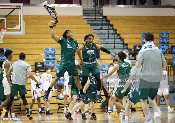 The Ohio Bobcats react to defeating the Virginia Cavaliers in the first round game of the 2021 NCAA Men's Basketball Tournament at Assembly Hall on...