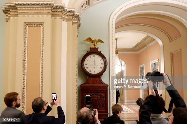 The Ohio Clock outside the Senate Chamber strikes midnight at the US Capitol January 20 2018 in Washington DC Lawmakers were unable to pass a...