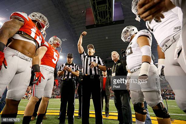 The Ohio State Buckeyes and the Oregon Ducks look for the coin toss prior to the College Football Playoff National Championship Game at ATT Stadium...
