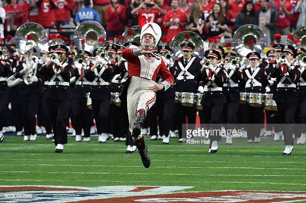 The Ohio State Buckeyes band marches onto the field before the BattleFrog Fiesta Bowl against the Notre Dame Fighting Irish at the University of...