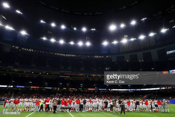The Ohio State Buckeyes celebrate after defeating the Clemson Tigers 49-28 during the College Football Playoff semifinal game at the Allstate Sugar...