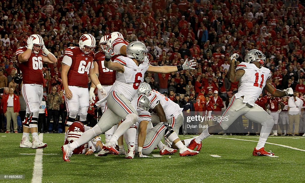The Ohio State Buckeyes celebrate after sacking Alex Hornibrook #12 of the Wisconsin Badgers to end the game in overtime at Camp Randall Stadium on October 15, 2016 in Madison, Wisconsin.