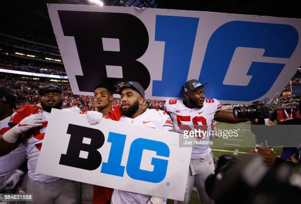 The Ohio State Buckeyes celebrate after their 2721 win over the Wisconsin Badgers during the Big Ten Championship game at Lucas Oil Stadium on...