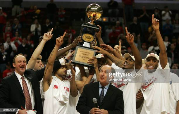 The Ohio State Buckeyes celebrate as they are presented with the trophy by Big Ten Commissioner Jim Delany following Ohio St's 6649 win against the...