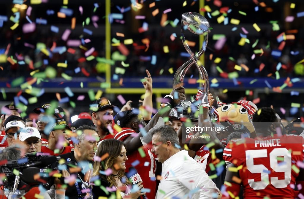 The Ohio State Buckeyes celebrate following the 82nd Goodyear Cotton Bowl Classic between USC and Ohio State at AT&T Stadium on December 29, 2017 in Arlington, Texas. Ohio State won 24-7.