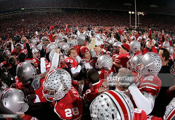 The Ohio State Buckeyes celebrate on the field with there fans after their 42-39 win against the Michigan Wolverines November 18, 2006 at Ohio...