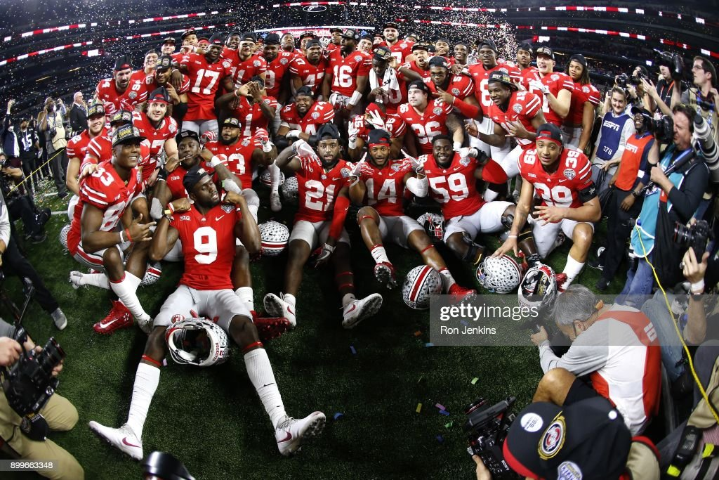 The Ohio State Buckeyes celebrate with a team photo following the 82nd Goodyear Cotton Bowl Classic between USC and Ohio State at AT&T Stadium on December 29, 2017 in Arlington, Texas. Ohio State won 24-7.