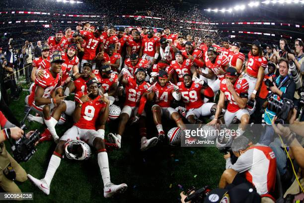 The Ohio State Buckeyes celebrate with a team photo following the 82nd Goodyear Cotton Bowl Classic between USC and Ohio State at ATT Stadium on...