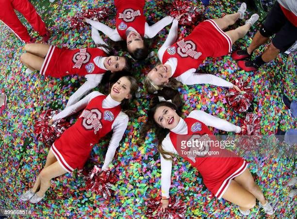 The Ohio State Buckeyes cheerleaders celebrate after the Ohio State Buckeyes beat the USC Trojans 247 during the Goodyear Cotton Bowl Classic at ATT...