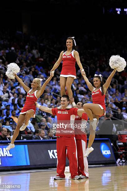 The Ohio State Buckeyes cheerleaders perform on the court during the game against the Kentucky Wildcats in east regional semifinal of the 2011 NCAA...