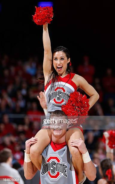 The Ohio State Buckeyes cheerleaders perform on the in the first half against the Iowa State Cyclones during the third round of the 2013 NCAA Men's...
