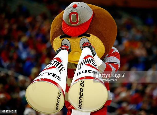 The Ohio State Buckeyes mascot Brutus Buckeye performs during the second round of the 2014 NCAA Men's Basketball Tournament against the Dayton Flyers...
