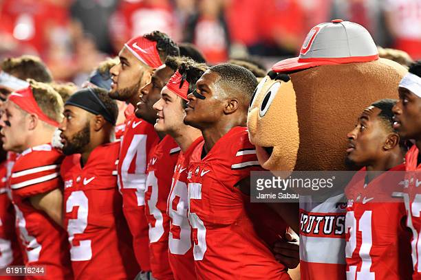 The Ohio State Buckeyes sing the Ohio State alma mater with Brutus Buckeye after Ohio State defeated the Northwestern Wildcats 2420 at Ohio Stadium...