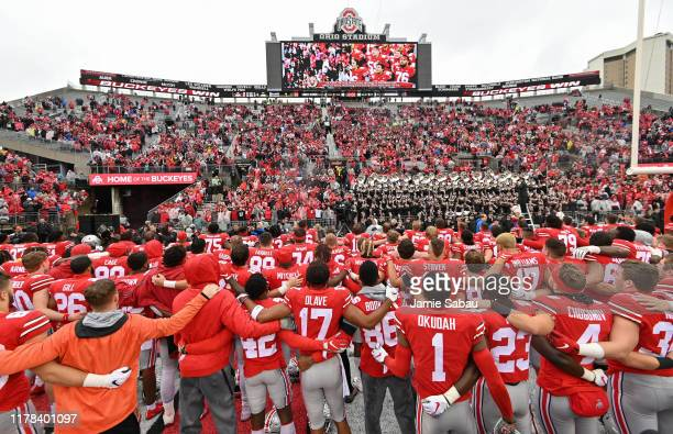 The Ohio State Buckeyes sing the school's alma mater after defeating the Wisconsin Badgers 387 at Ohio Stadium on October 26 2019 in Columbus Ohio