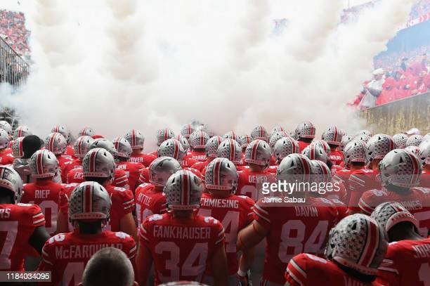 The Ohio State Buckeyes take the field before a game against the Wisconsin Badgers at Ohio Stadium on October 26 2019 in Columbus Ohio
