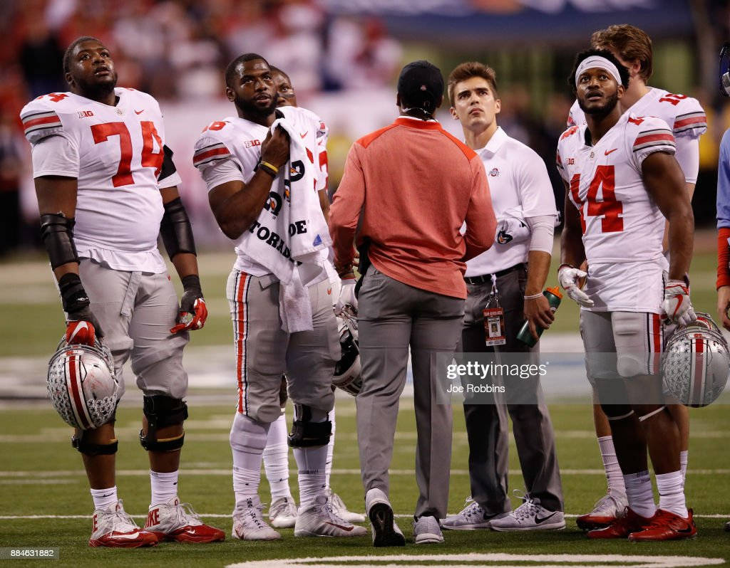 The Ohio State Buckeyes watch a replay of afourth-down run in the fourth quarter against the Wisconsin Badgers during the Big Ten Championship game at Lucas Oil Stadium on December 2, 2017 in Indianapolis, Indiana. The Ohio State Buckeyes won 27-21.