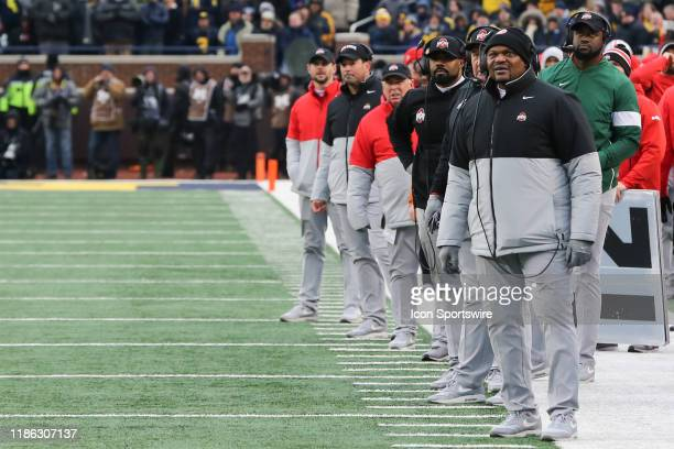 The Ohio State coaching staff look at the scoreboard during a regular season Big 10 Conference game between the Ohio State Buckeyes and the Michigan...