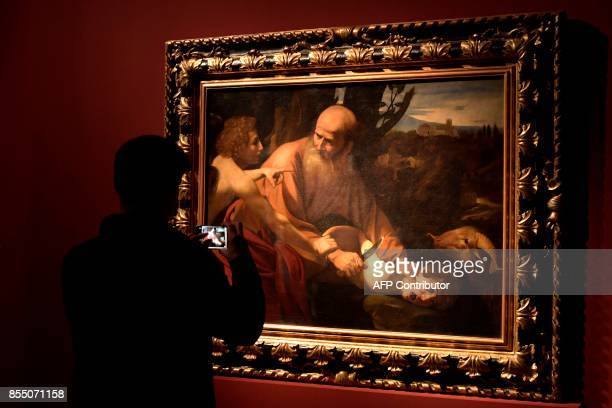The oil painting on canvas called Sacrificio d'Isacco by Italian painter Michelangelo Merisi better known as Caravaggio is displayed on a screen...