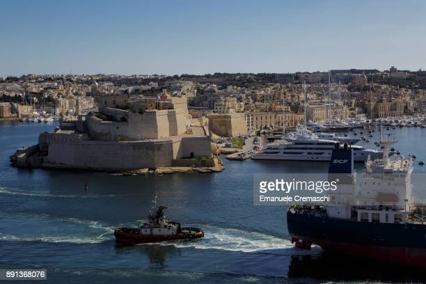 The oil products tanker SCF Amur sails past the Fort Saint Angelo in the Grand Harbour on December 7 2017 in Valletta Malta Valletta a fortified town...
