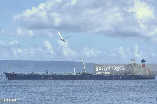 CONTENT] The oil tanker British Curlewis waiting for a Christmas Island barge to take ashore Asylum Seeker survivors picked up north of Christmas...