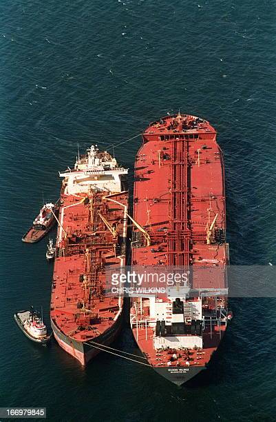 The oil tanker Exxon Baton Rouge continue to off load crude oil from the crippled tanker Exxon Valdez in Prince William Sound 28 March 1989, four...