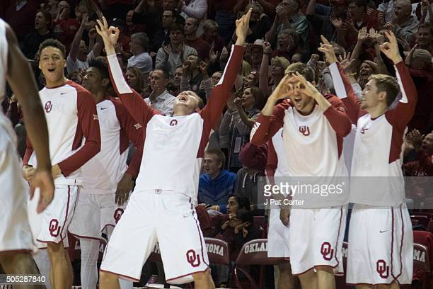 The Oklahoma bench celebrates after the Sooners tied the game with West Virginia during the second half of a NCAA college basketball game at the...