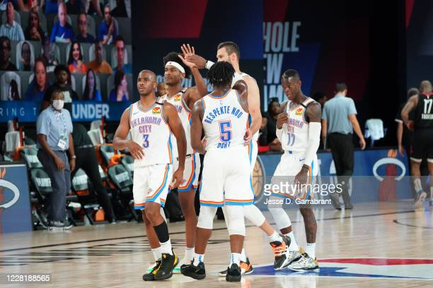 The Oklahoma City Thunder hi-five after winning a game against the Houston Rockets during Round One, Game Four of the NBA Playoffs on August 24, 2020...