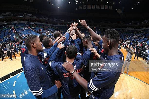 The Oklahoma City Thunder huddle before facing off against the Minnesota Timberwolves during a preseason game on October 7 2015 at Target Center in...