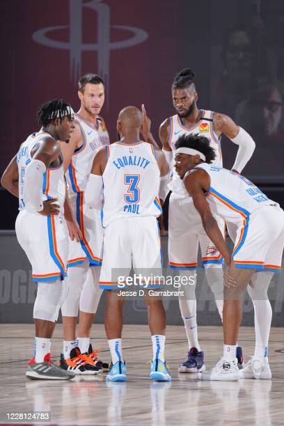 The Oklahoma City Thunder huddle up during the game against the Houston Rockets during Round One, Game Two of the NBA Playoffs on August 20, 2020 at...