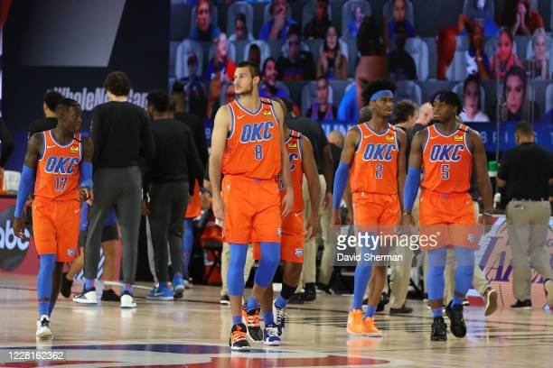 The Oklahoma City Thunder look on against the Houston Rockets during Round One, Game Three on August 22, 2020 in Orlando, Florida at the Field House....