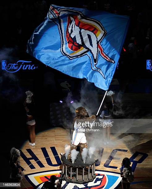 The Oklahoma City Thunder mascot waves a flag at midcourt before the Thunder take on the Miami Heat in Game Two of the 2012 NBA Finals at Chesapeake...