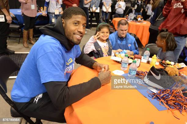 The Oklahoma City Thunder player Paul George along with coaches and staff hosts it's 10th annual Holiday Assist event for 80 children from the Norman...