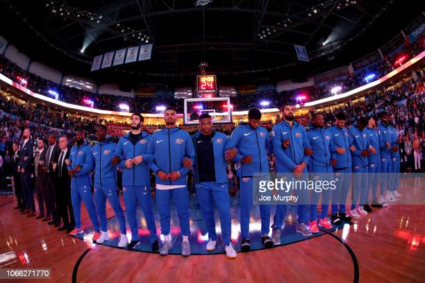 The Oklahoma City Thunder stand for the National Anthem against the Cleveland Cavaliers on November 28 2018 at Chesapeake Energy Arena in Oklahoma...