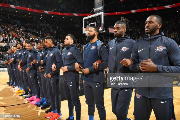 The Oklahoma City Thunder stands for the National Anthem before the game against the Toronto Raptors on March 22 2019 at the Scotiabank Arena in...