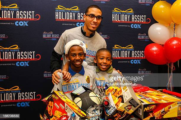 The Oklahoma City Thunder team takes 10 families in Sunbeam Family Services' Grandparents Raising Grandchildren program on a holiday shopping spree...