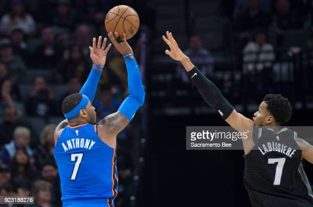 The Oklahoma City Thunder's Carmelo Anthony left hits a 3pointer over the Sacramento Kings' Skal Labissiere at Golden 1 Center in Sacramento Calif on...