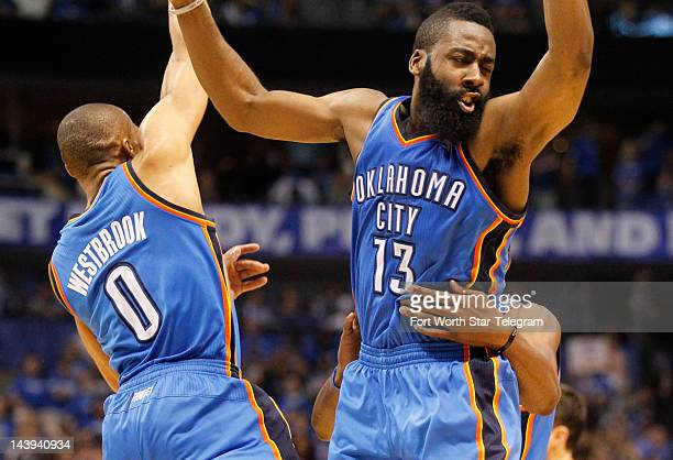 The Oklahoma City Thunder's James Harden join teammates Russell Westbrook and Kevin Durant in celebrating a late fourthquarter lead against the...
